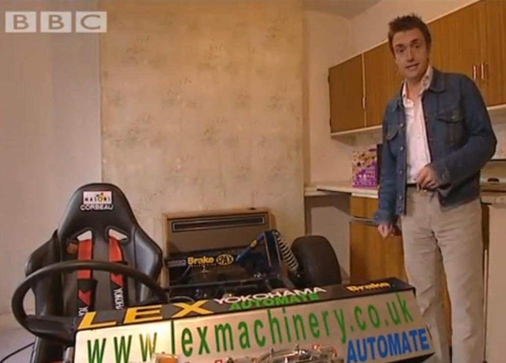 man builds car in kitchen
