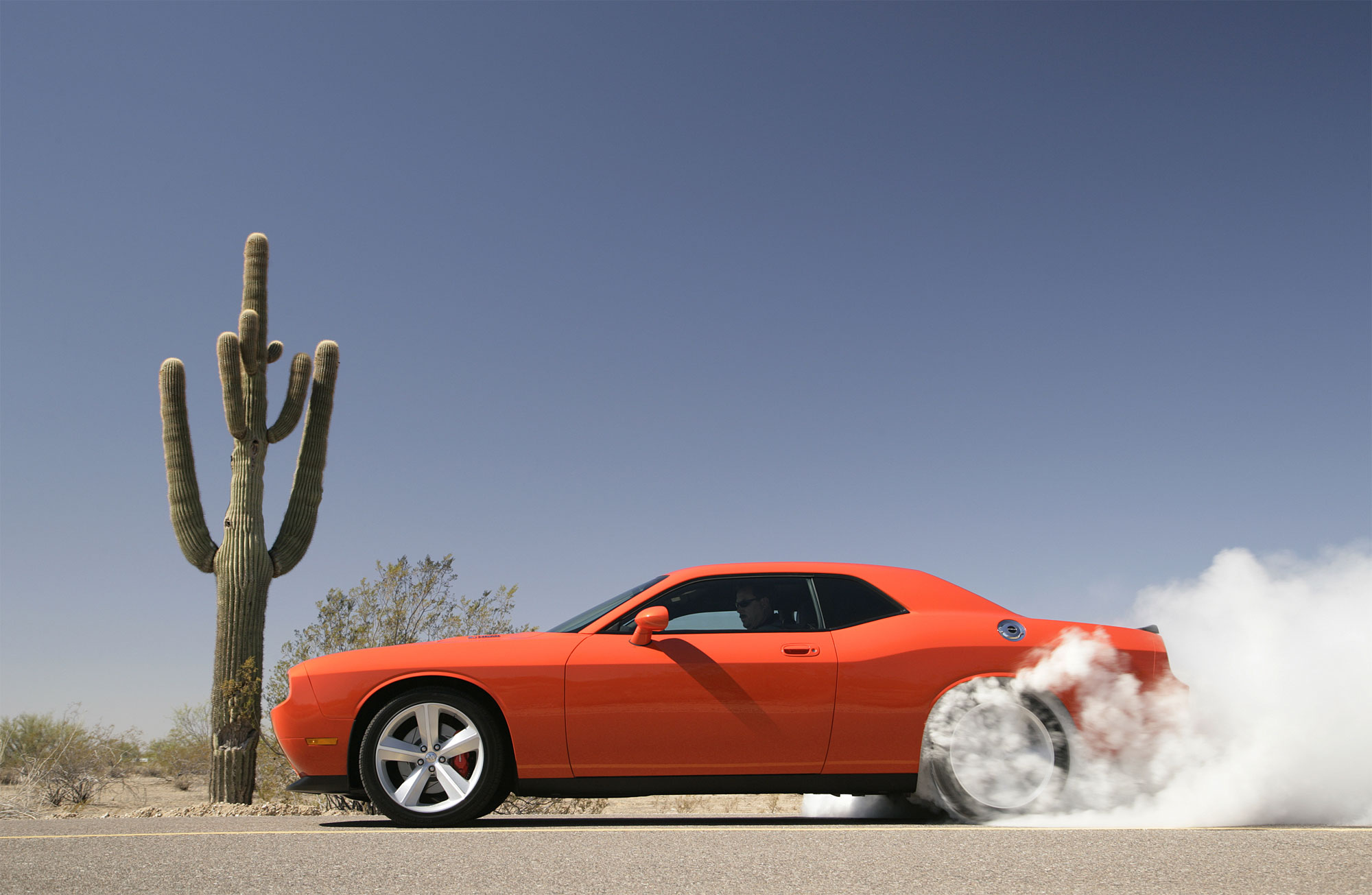 Profile, driver's side, tires smoking, 2008 Dodge Challenger SRT8