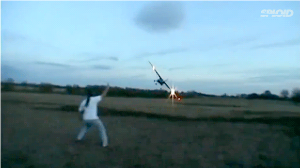 Watch This Drunk Man Narrowly Avoid The Wing Of A Low Flying Plane! (CRAZY!)