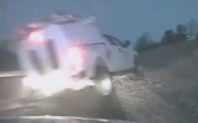 Truck Goes Airborne On Interstate Narrowly Missing Police Officers (VIDEO)