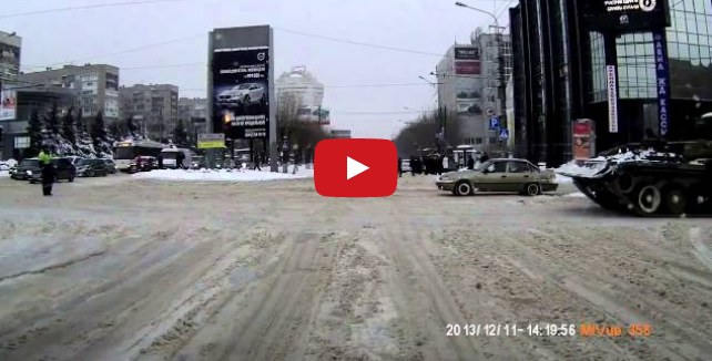 A Tank Towing A Truck? Towing Services in Russia Are Impressive! (VIDEO)