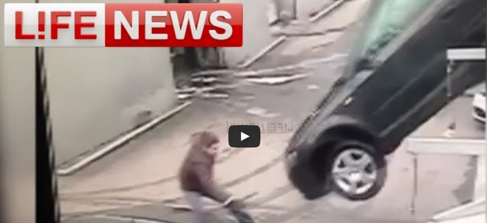 OOOPS! Audi Employee Is Almost Crushed By The Car After Forgetting Handbrake (VIDEO)