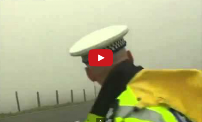 Dumb Cop Jumps out on Motorcyclist