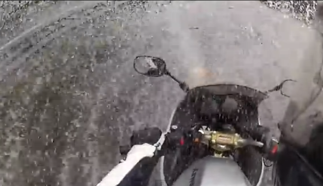 This Biker Terrifyingly Charges Through Flood Water On Highway (VIDEO)