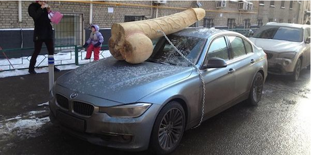 Don't Mess With The President: Putin Critic Finds 200-Pound Giant Wooden Dick On The Hood Of His Car