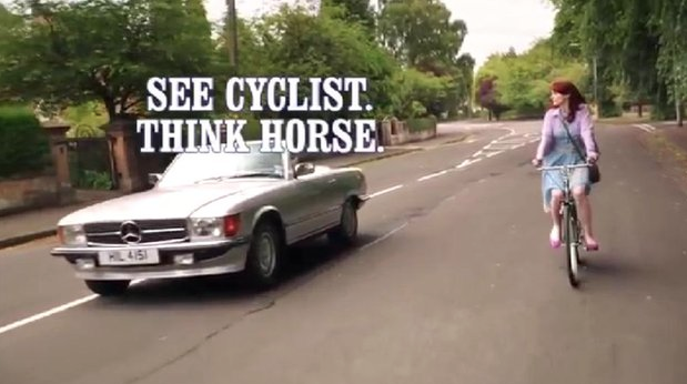 see cyclist think horse