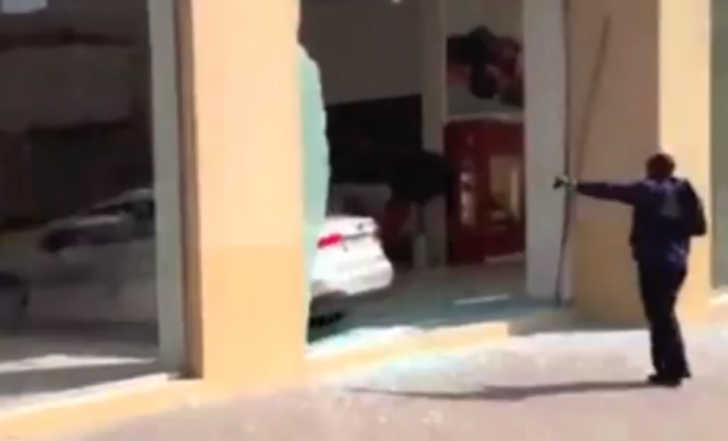This amateur footage from Doha, Qatar, shows a Kia car being so annoyed at how ugly it is that it crashes into a Ferrari/Masserati showroom in pure jealousy!