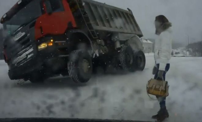 truck tips over in snow