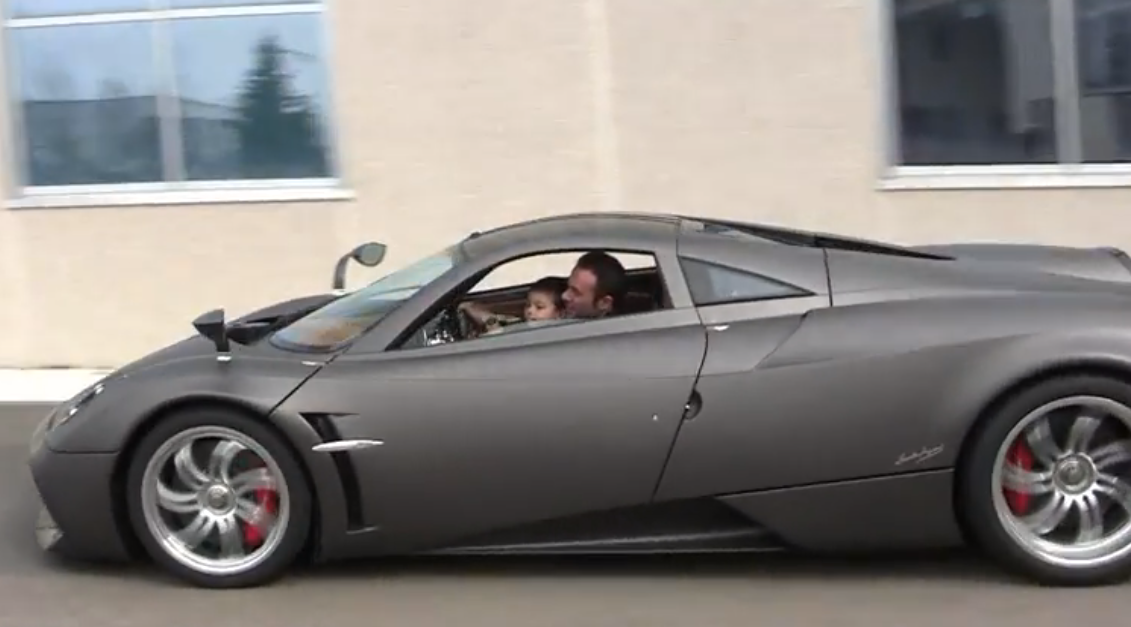 Pagani Test Driver takes his son on lap