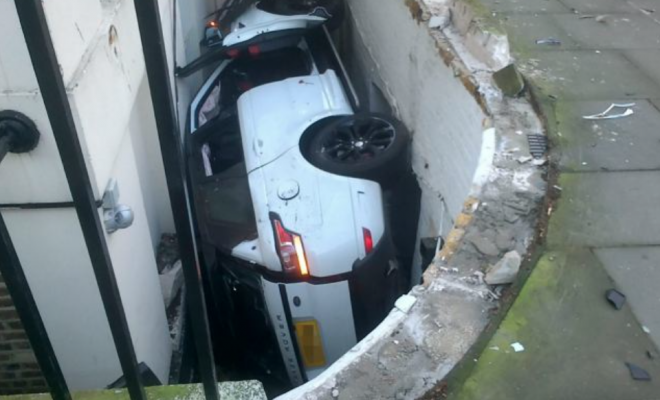 £80,000 range rover wedged in a basement