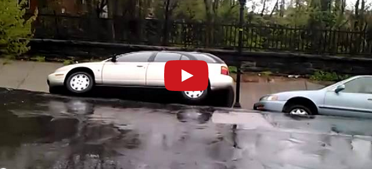 Cars Swallowed By Giant Sinkhole In Baltimore: Video