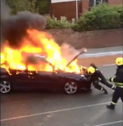hero firefighter burning car