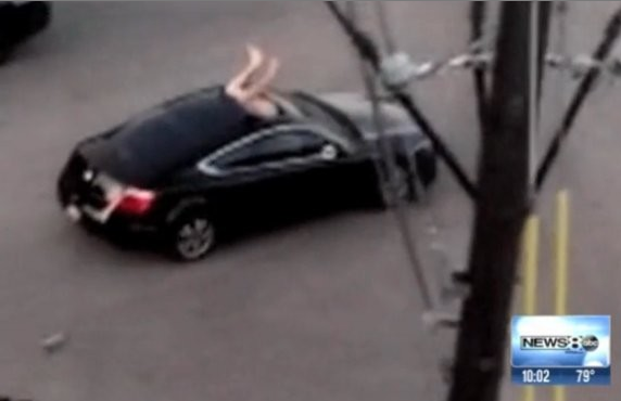naked-man-jumps-through-sunroof